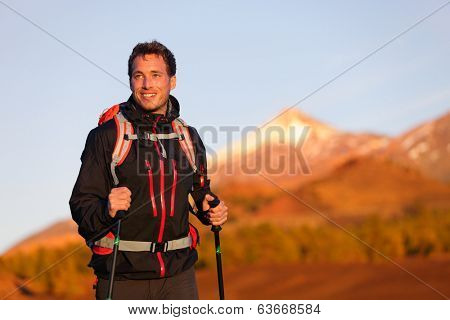 Hiker man hiking living healthy active lifestyle. Trekking male model walking in beautiful mountain nature landscape on volcano Teide, Tenerife, Canary Islands, Spain.