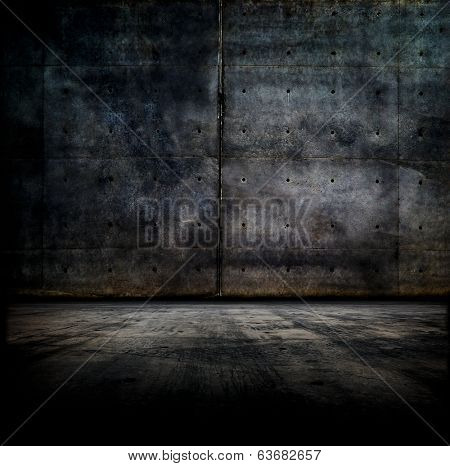 Black room.  Dark concrete wall and floor.