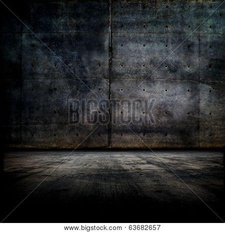 Black room.  Dark concrete wall and floor.