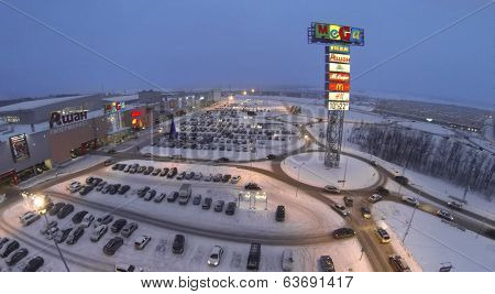 SAMARA, RUSSIA - JAN 05, 2014 : Aerial view to superstore Mega in Samara with car parking in evening.