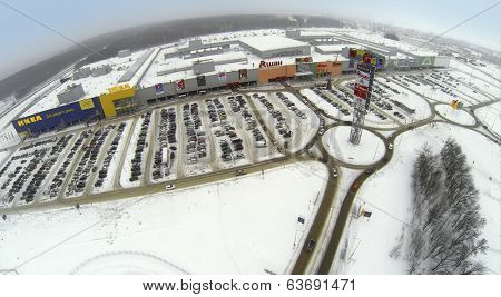 SAMARA, RUSSIA - JAN 05, 2014 : Aerial view to territory of superstore Mega in Samara with large car parking.