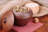 Pot with kutia -  traditional Christmas sweet meal in Ukraine, Belarus and Poland, on wooden background poster
