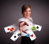 Pretty young woman playing with poker cards and chips  poster