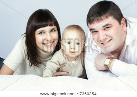 Happy Family - Father, Mother And Baby