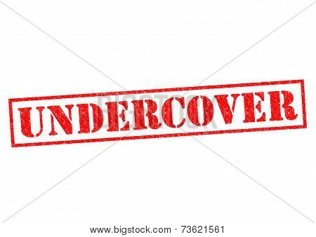 UNDERCOVER red Rubber Stamp over a wite background. poster
