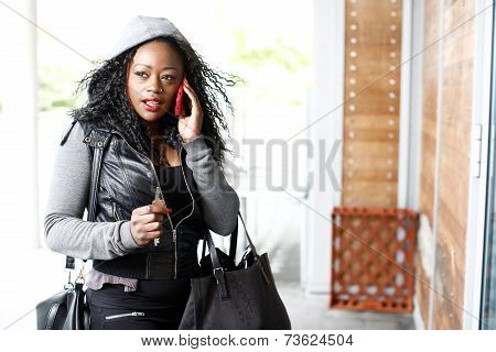 Attractive Young Woman Talking On Her Smartphone
