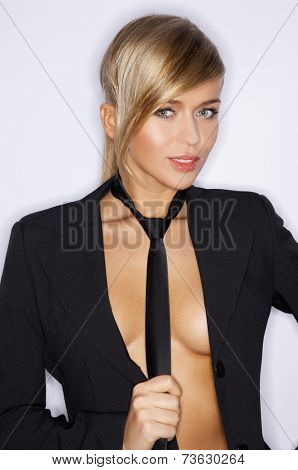 Pretty Young Woman in Unbutton Black Coat and Neck Tie Portrait. Looking at Camera. Isolated on White Background.