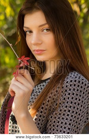 Young caucasian sensual woman in romantic autumn scenery.Portrait of pretty young girl in the forest