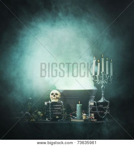 Halloween background with a lot of different witchcraft tools: skull, candles, book, poison and smoke