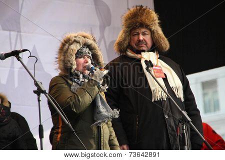 The representative of Russia sitting Olga Romanova and politician Gennady Gudkov