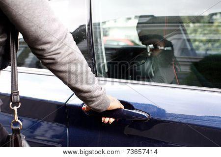 Woman In Jacket Opening Car Door
