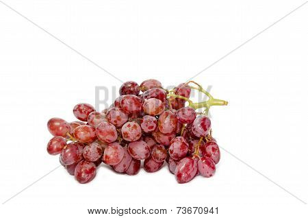 The red Grapes on the white background.