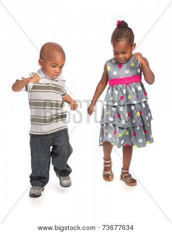 Smiling Young African American Brother and Sister Portrait Isolated on White Background Dancing Together