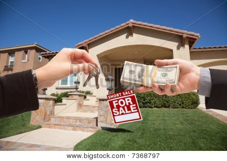 Handing Over Cash For House Keys and Short Sale Real Estate Sign in Front of Home. poster