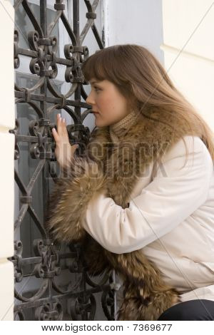 Young Woman Looking In Window