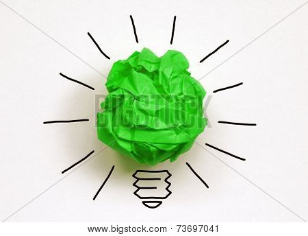 Inspiration environment concept crumpled green paper light bulb metaphor for good idea and environmental conservation