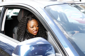 Young Attractive African Woman Driving Her Car