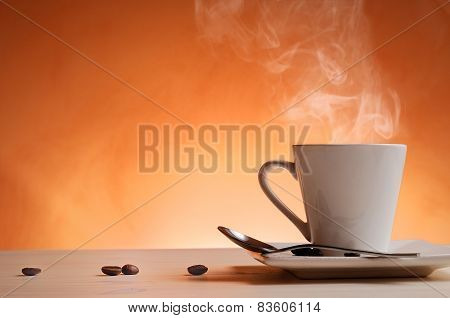 Cup Of Coffee With Orange Background Front View