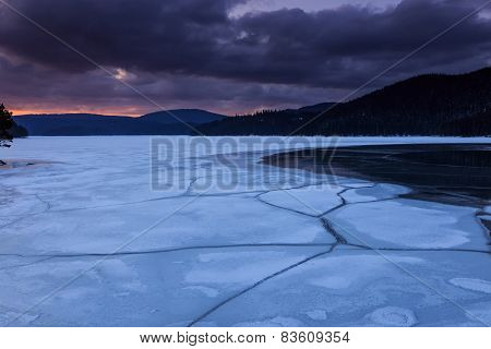 Frozen Lake And The Dark Clouds, Winter Landscape