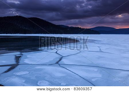 Creaking Ice Of Frozen Lake In The Mountain