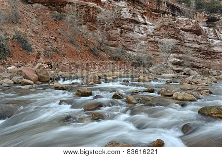 River and rapids in red rock landscape in Zion National Park, Utah