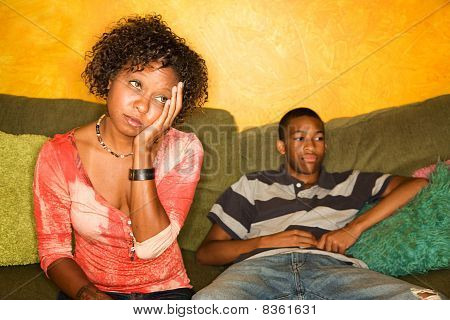 Worried African-american Woman Sitting With Teen