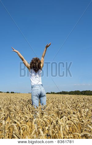 Young Woman In Cornfield