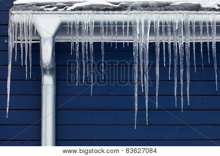 Icicles on the blue roof.