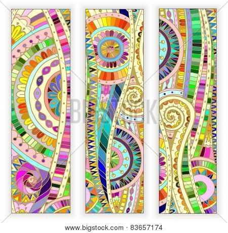 Set of  doodle ethnic cards on wood background.