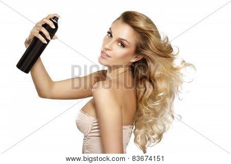 Beautiful Model Applying Spray  On Windy Hair