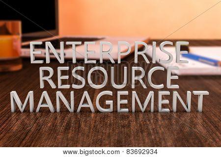 Enterprise Resource Management - letters on wooden desk with laptop computer and a notebook. 3d render illustration. poster