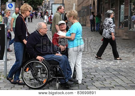 Nurnberg, Germany - July 13 2014: Tourists In Wheelchairs On Hauptmarkt, The Central Square Of Nurem