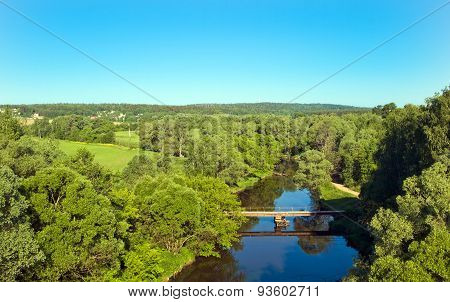 Bridge over the river flowing in the forest