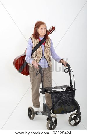 Elderly Lady With Rollator And Musical Instruments.