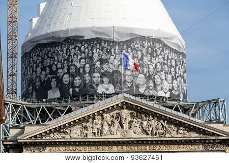 PARIS, FRANCE - SEPTEMBER 8, 2014: Paris - The pediment of Pantheon against the background of repaired dome. Construction of the building started in 1757 and was finished in 1791