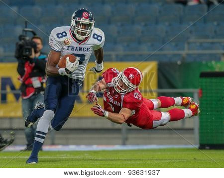 GRAZ, AUSTRIA - JUNE 2, 2014: WR Anthony Dable (#8 France) runs with the ball during the Football EC European Championchip in Graz, Austria.