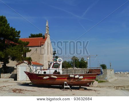 A wooden fishing vessel on a boat slipway