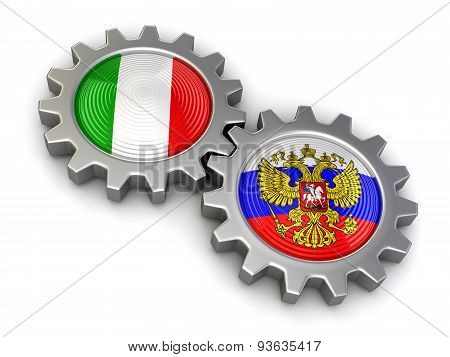 Russian and Italian flags on a gears (clipping path included)