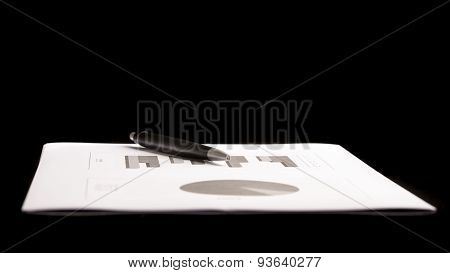 Business Document With Pen Isolated On Black