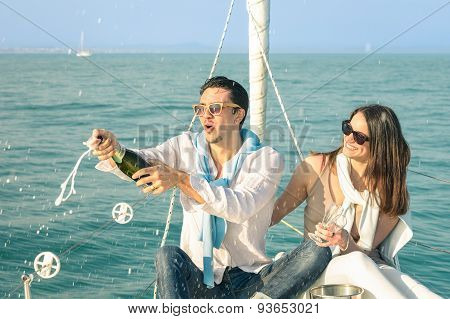 Young Couple In Love On Sailing Boat Cheering With Champagne Wine Bottle - Happy Girlfriend Birthday
