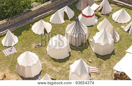 Medieval tent settlement reconstruction Bolkow castle in Poland. poster