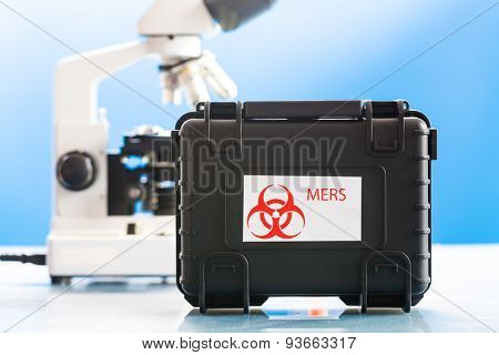 Safe case with epidemiologically dangerous viruses coronavirus and microscope in laboratory