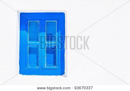 Blue wooden window with clear white wall, Greece