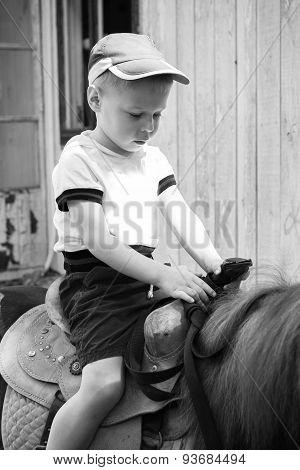 Little boy riding on a pony,