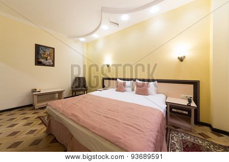 ADLER, RUSSIA - JULY 22, 2014: Interior of a hotel room with a huge bed and painting on the wall in Shine House hotel