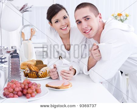 Smiling Lovers In The Kitchen