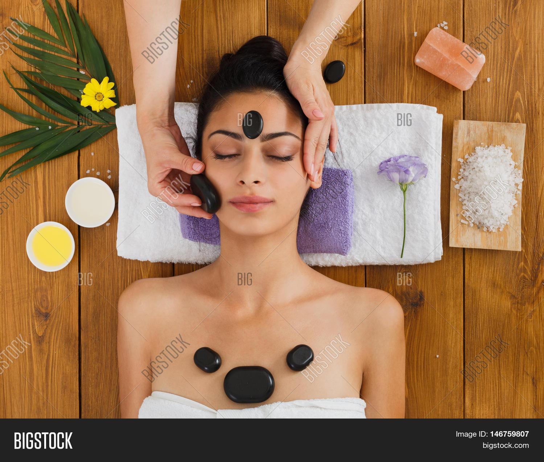 black marble stone face massage image & photo | bigstock