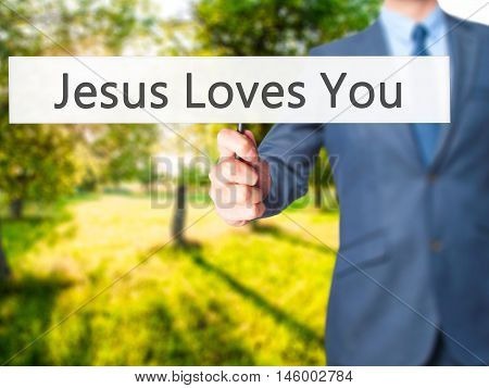 Jesus Loves You - Businessman Hand Holding Sign