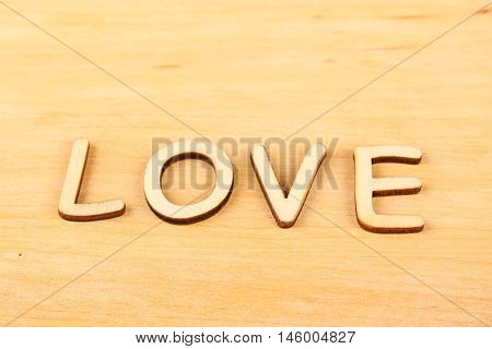 Wooden text Love. Letters on a wooden background