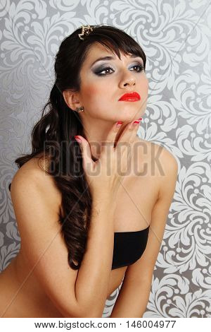 Close-up of a beautiful young woman. Makeup and hairstyle
